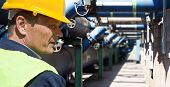 Maintenance engineer at the waste water management system of a huge factory poster