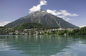 Lake Thun with village Spiez and Pyramid Mount Niesen Switzerland poster