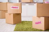 Man moving house and relocating with fragile items poster