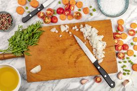 Prep Time, Or Mise En Place. An Overhead Photo Of Professional Chef's Knives, Shot From Above On A C