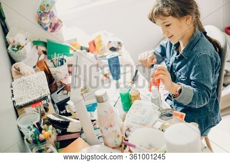 casual indoor portrait of child girl with laptop lying on bed at home portrait of young child girl crafting at home