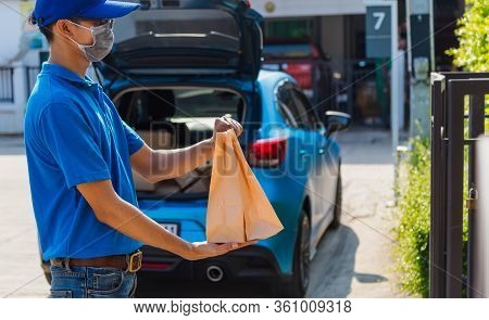 Asian Young Delivery Man Courier Online With Food Order Takeaway Paper Bag Containers He Protective