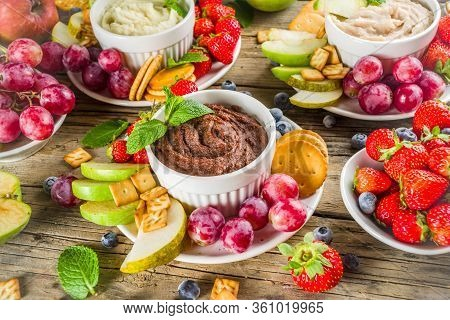 Vegan Food For Breakfast, Snack. Homemade Sweet Hummus With Strawberries, Apple, Crackers, Grapes. V