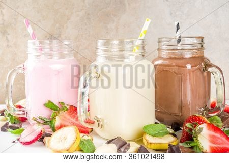 Three Mason Jars With Milkshakes Or Smoothie. Summer Healthy Breakfast, Lunch Drinks - Banana, Choco