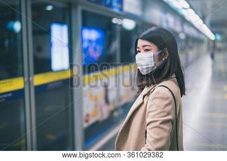 Young Asian Woman Wearing Protective Face Mask Stand In Line During Waiting Underground Train In Sub