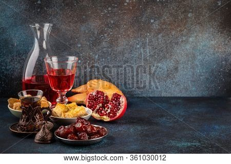 Ramadan Kareem Iftar Evening Meal With Dates, Baklava, Traditional Arabic Sweets, Fruit, Arab Tea, R