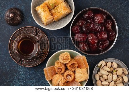 Traditional Arab Fresh Hot Tea Time With Sweets, Baklava, Dates, Lokum From Above. Ramadan Snack Wit