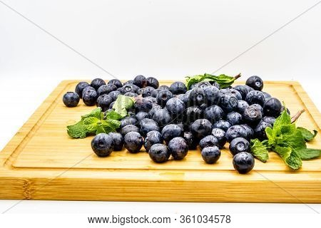 Blueberries On A Wooden Cutting Board. Calgary, Alberta, Canada