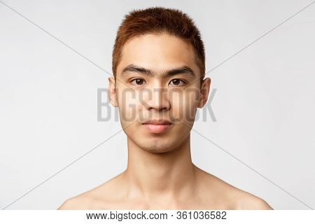 Beauty, Skincare And Men Health Concept. Headshot Of Handsome Young Asian Man With No Blemishes, Per