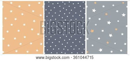 Cute Abstract Starry Sky Seamless Vector Patterns. White Freehand Stars On A Gray, Graphite And Pale