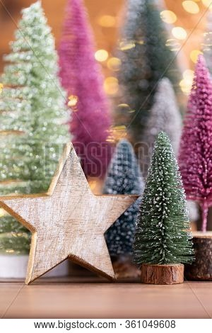 Colorful Christmas Tree On Wooden, Bokeh Background. Christmas Holiday Celebration Concept. Greeting