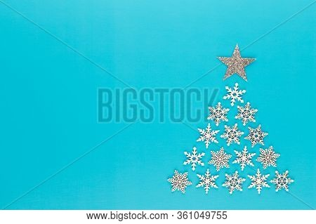Christmas Tree Made From White Snow Flake Decorations On Red  Background With Empty Copy Space For T