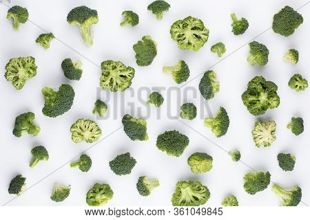 Broccoli Pattern Isolated On A White Background. Various Multiple Parts Of Broccoli Flower. Top View