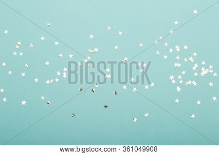 Glittering Christmas Background. Star Dust And Golden Glitter. Holidays Background For Web And Print