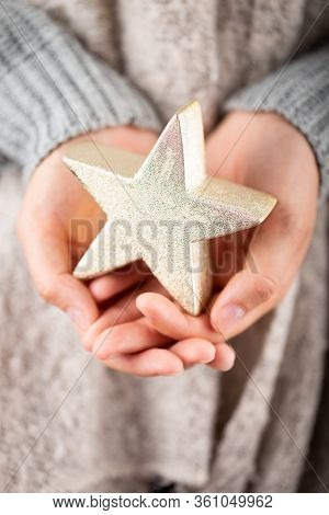 Winter Concept Young Hands Holding Christmas Decor.  Christmas Decoration Idea. Christmas Decor In T
