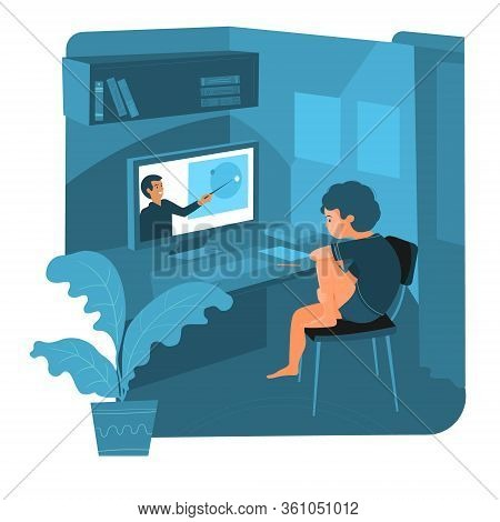 The Boy Is Sitting At Home Watching A Video Lesson. He Is Studying Remotely