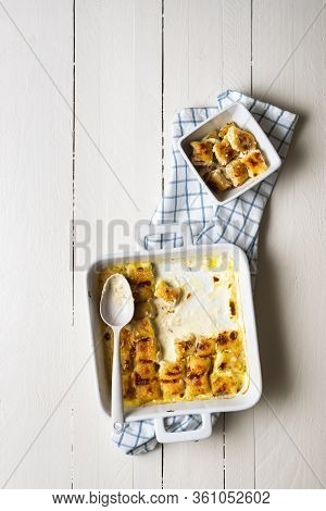 Freshly Baked Cheese Gnocchi Tray On White Table. Flat Lay With Handmade Gnocchi With Melted Cheese