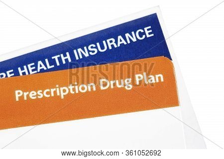 Health Insurance Card With A Prescription Drug Plan Membership Card Isolated On White