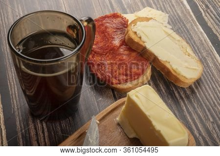 Fresh Wheat Toast With Butter And Sausage, A Wooden Butter Dish With A Piece Of Butter And A Mug Of