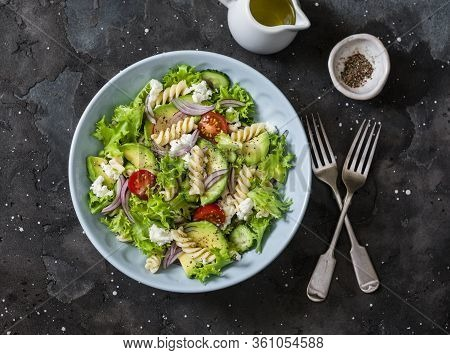 Vegetarian Healthy Lunch - Pasta Salad With Fresh Vegetables, Avocado And Feta On A Dark Background,