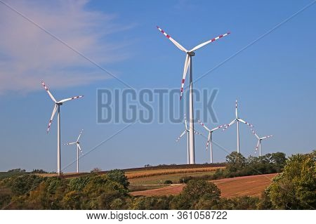 Wind Power Is The Use Of Air Flow Through Wind Turbines To Mechanically Power Generators For Electri