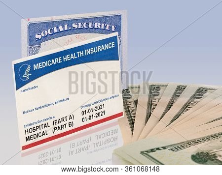 Usa Social Security Card And A Medicare Health Insurance Card With 20 Dollar Paper Currency To Show