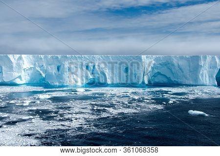 Large Bright Blue Iceberg Floating In Antarctica.