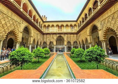 Seville, Andalusia, Spain - April 19, 2016: Patio De Las Doncellas In Royal Alcazars Of Seville Or R