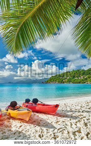 Beautiful Petite Anse beach with kayaks and palm tree at Seychelles, Mahe