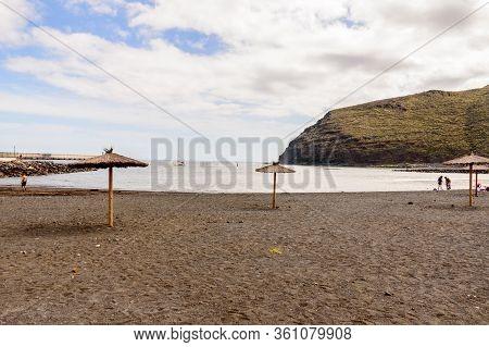 Black Sand Beach With A Beautiful Sky Practically Deserted In San Sebastian De La Gomera. April 15,