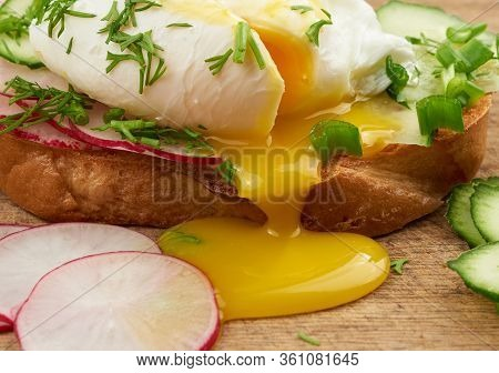 Sandwich On Toasted White Slice Of Bread With Poached Eggs, Dill And With Slices Of Green Onions, Ye