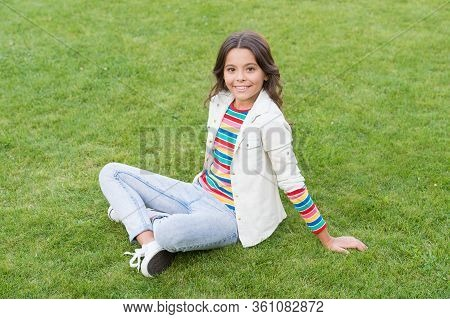 Having Rest In Summer Park. Concept Of Rest And Relaxation. Spring Nature Enjoyment. Cute Girl Rest