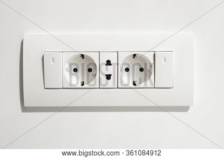 Block Of White Outlets, Consisting Of Two Eu Standard Outlets With Grounding And One Us Standard Out