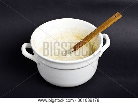 Dough In The White Pot On The Dark Background