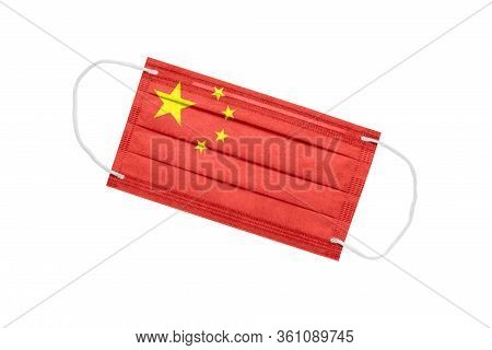 Medical Face Mask With The Flag Of China, Isolated On White Background. Pandemic Concept In China. A