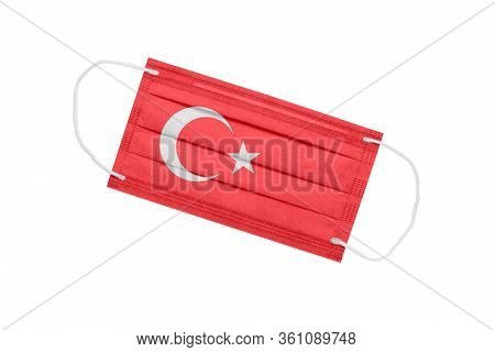Medical Mask With Flag Of Turkey Isolated On A White Background. Turkey Pandemic Concept. Attribute