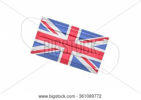 Medical Mask With Uk Flag Isolated On A White Background. Uk Pandemic Concept. Attribute Of Coronavi