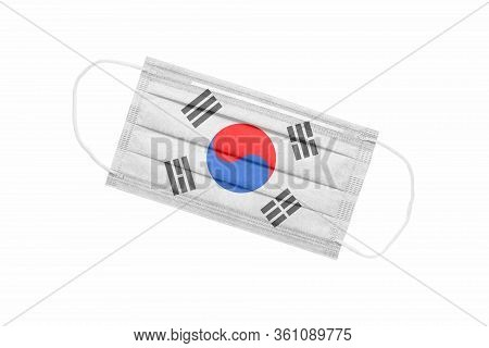 Medical Face Mask With Flag Of South Korea Isolated On White Background. Pandemic Concept In South K