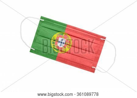 Medical Face Mask With Flag Of Portugal Isolated On A White Background. Portugal Pandemic Concept. A