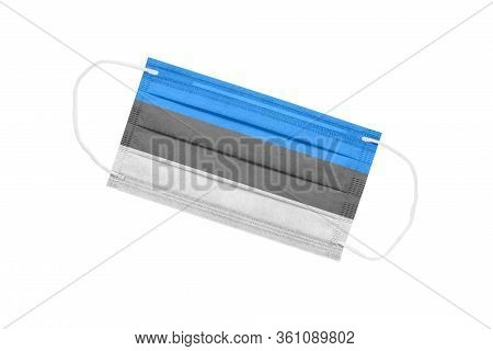 Medical Face Mask With Flag Of Estonia Isolated On White Background. Pandemic Concept In Estonia. At