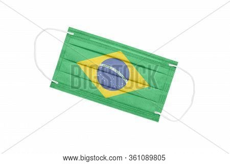 Medical Face Mask With Flag Of Brazil Isolated On A White Background. Brazil Pandemic Concept. Attri