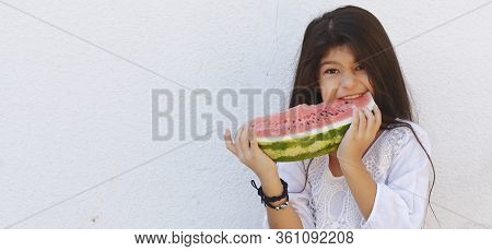 Portrait Of A Beautiful Teen Girl Eating Watermelon At Outdoors. A Little Girl Holding In Hands Big
