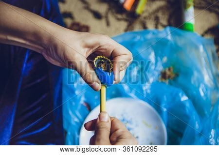 An Unrecognizable Woman Hands Sharpen Colorful Pencil. Top View Of Hands Sharpening A Pencil With A