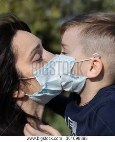 Mother And Son In Medical Masks