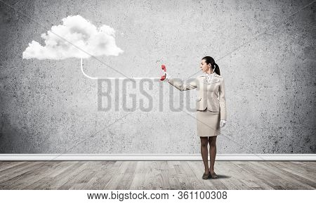 Young Woman With Red Retro Phone And White Cloud On Grey Wall Background. Call Center Operator In Wh