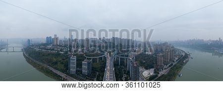 Dec 23, 2019 - Chongqing, China: Pano Aerial Drone Shot Of Caiyuanba Flyover With Traffic In Bleak M