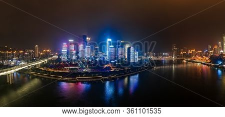 Dec 22, 2019 - Chongqing, China: Panoramic Aerial Night View Of Hong Ya Dong Cave And Skyscrapers By