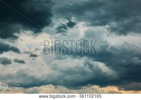 Dramatic dark sky with heavy rainy clouds, may be used as background