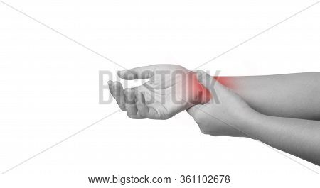 Close Up Women Using Hand Touching A Wrist. Discomfort Around The Wrist Is Usually Caused By Long-te