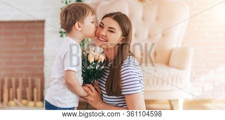 The Boy Gives Beautiful Bouquet Of Flowers To His Mother, Mother S Day, March 8, Spring Time, Son Lo